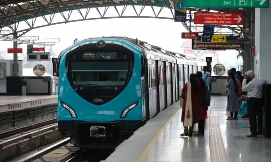 Passengers waits to board a Kochi Metro train at Aluva station in Kochi, Kerala