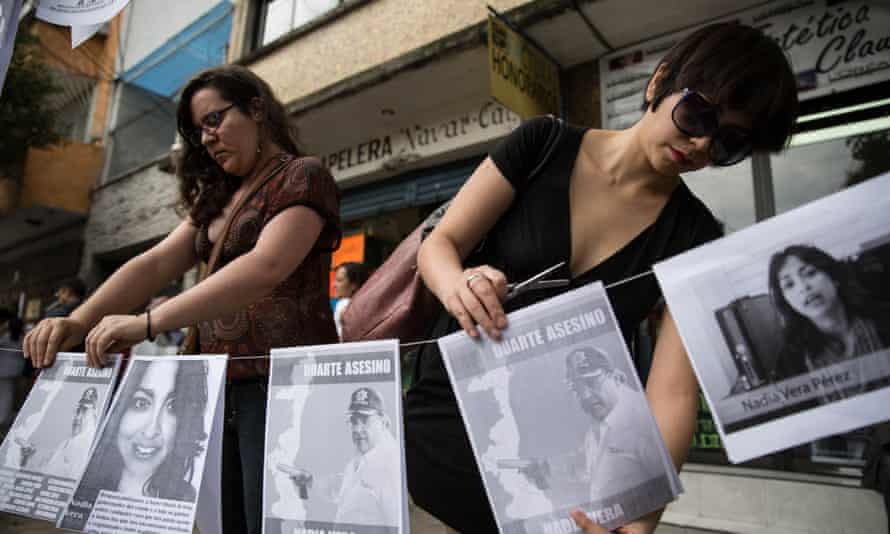 Banners link the death of Nadia Vera, who was killed with four other people, to former Veracuz governor Javier Duarte.