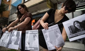 Women place portraits of the social activist Nadia Vera and Javier Duarte, the governor of Mexico's Veracruz state, outside the apartment where she was murdered alongside Alejandra Negrete, Mile Virginia Martín, Yesenia Quiroz and Rubén Espinosa.