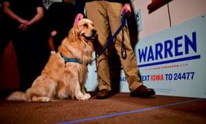 Elizabeth Warren's husband, Bruce Mann, and golden retriever, Bailey Warren, greet supporters on 29 January 2020 in Fort Dodge, Iowa.