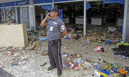 A security guard outside a supermarket after protests against the Nicaraguan government's social security reforms, which have now been dropped.