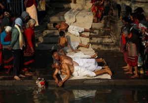Bhaktapur, Nepal: Devotees offer prayers by rolling on the ground during the Swasthani Brata Katha festival