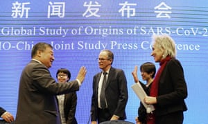 Marion Koopmans, right, and Peter Ben Embarek, center, of the World Health Organization team say farewell to their Chinese counterpart Liang Wannian, left, after a WHO-China Joint Study Press Conference held at the end of the WHO mission in Wuhan, China, on Tuesday.