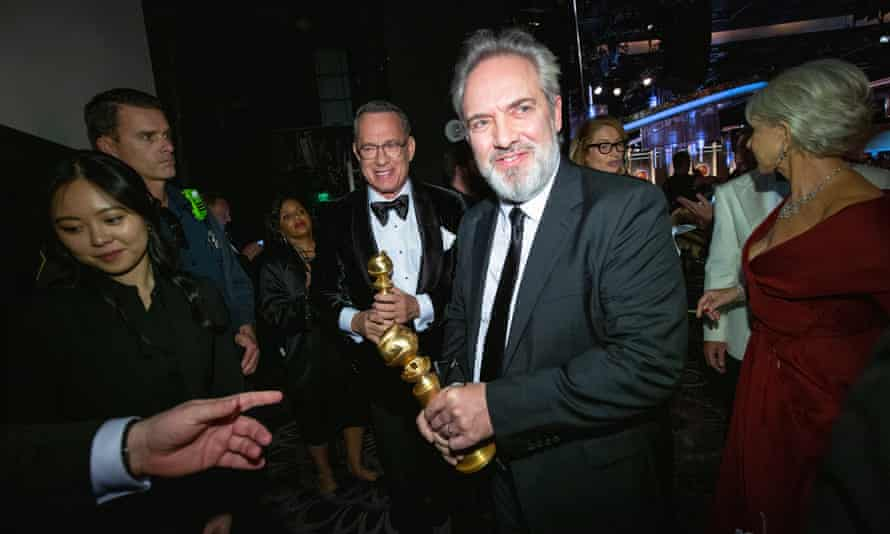 Sam Mendes and Tom Hanks with their Golden Globes.