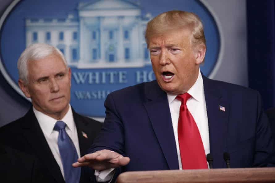 Trump with Mike Pence at the White House. Experts warn that conflicting statements could complicate public health officials' response to the crisis.