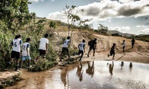 Young people of the Macuxi tribe in Uiramutã going to play football.
