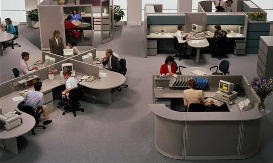 Open-plan office, people working at terminals