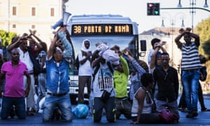 Migrants protest after they were evicted from a building they were occupying in Rome.