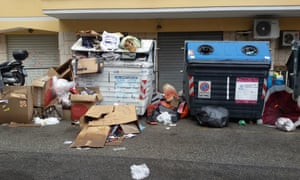 Mounds of uncollected rubbish have been piling up in parts of Rome since Christmas Eve