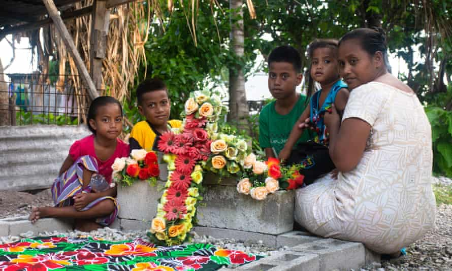 Eritara Aati Kaierua's wife Tekarara, with their four children Robert, Aatii, Elizabeth and Tutu at his grave in Tarawa, Kiribati. The family have been left without their father after he was murdered on a fishing boat. Murder, fishing, over fishing.
