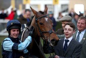 Jockey Rex Dingle celebrates winning the Martin Pipe Conditional Jockeys Handicap Hurdle with Indefatigable