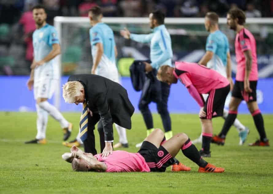 Gordon Strachan comforts Leigh Griffiths after defeat in Slovenia put an end to Scotland's World Cup dream