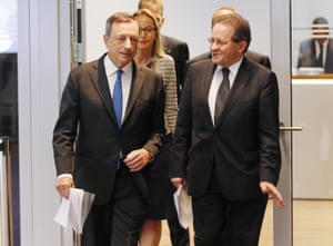 President of European Central Bank Mario Draghi, left, and vice President Vitor Constancio, right, are on their way to a news conference in Frankfurt, Germany, Thursday, Sept. 3, 2015, following a meeting of the ECB governing council. (AP Photo/Michael Probst)