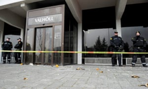 Police stand guard during a protest outside the Independence Party's headquarters in Reykjavik on April 5.