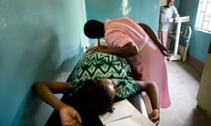 A pregnant woman is examined at hospital in Uganda