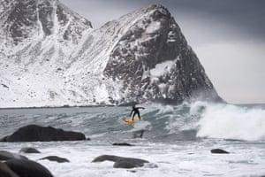 Tom Carroll, 55, an Australian surf legend from the 80s, rides a wave