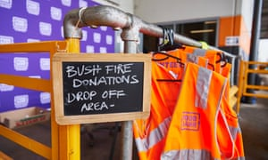A sign at the Food Bank Distribution Centre in Glendenning, Sydney, for the public to drop off supplies bound for areas impacted by bushfires. Experts advise that unless you are responding to a specific request for goods or services, donating cash is more beneficial.