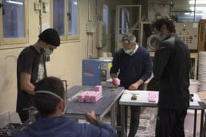 Serge Bruna and soap artisans cut bars of soap