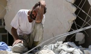 Man in tears after air strike on eastern Aleppo