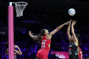 England's Geva Mentor attempts to block a shot by New Zealand's Maria Folau.