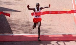 Eliud Kipchoge crosses the finish line to win the men's elite race at the London Marathon.