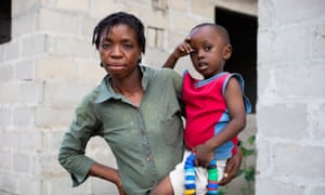 Royda Joseph, 32, who lives next to Dar es Salaam's main dump, and her son Victor.