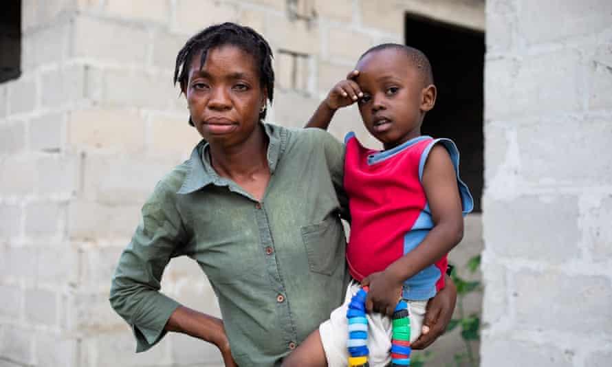 Royda Joseph, 32, who lives next to Dar es Salaam's main dump, and her son Victor.