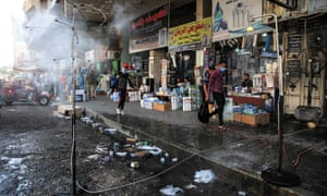Sprinklers in the street in Baghdad, Iraq, where temperatures reached 51C in July.