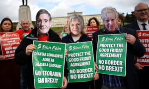 Members of Sinn Féin hold posters during a recent protest against Brexit outside Stormont in Belfast.