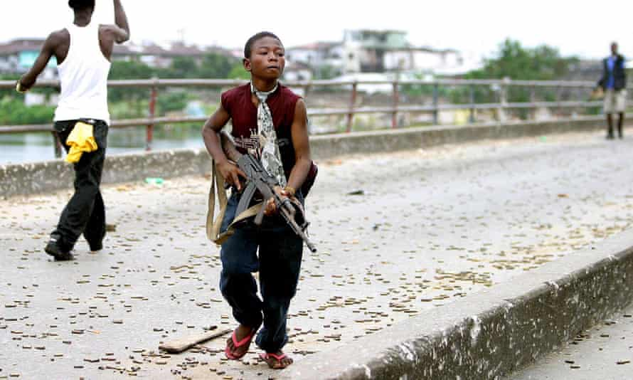 A Liberian child soldier fighting with Charles Taylor's forces in 2003