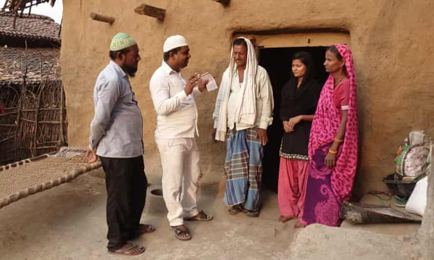Members of the DRA meet Safik Ansari and his family in Neura village, Jharkand state