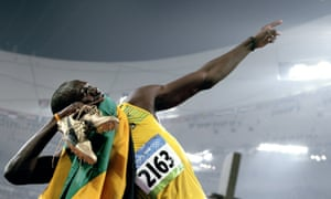 Usain Bolt celebrates winning the men's 200m final at the Bird's Nest stadium during the 2008 Beijing Olympic Games on 20 August 2008.