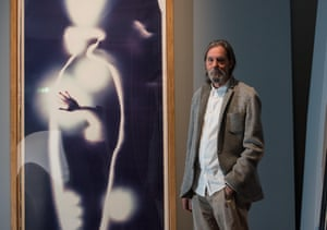 Hands free … Ulay stands next to Self-Portrait, from 1990.