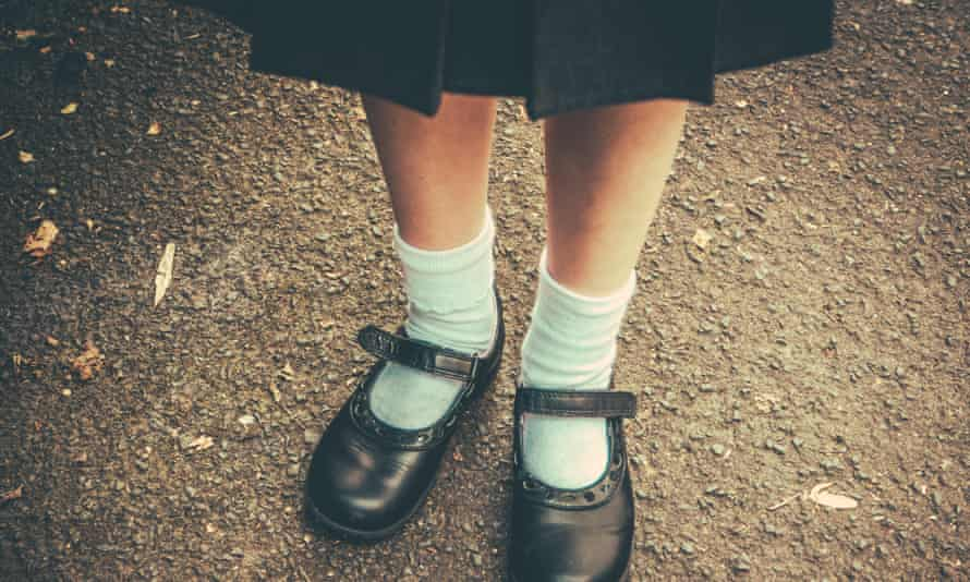 School girl's feet in uniform
