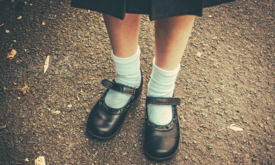 Retro image of schoolgirl's feet in uniform
