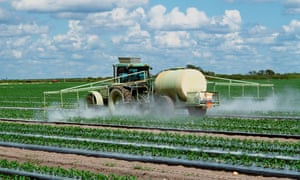 Field being sprayed with pesticide