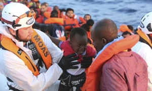 A child cries while being rescued