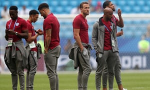 England players inspect the playing surface.