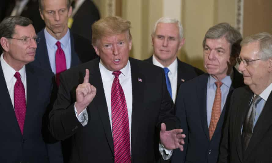 In a picture from January 2019, senior Republicans John Barrasso, John Thune, Mike Pence, Roy Blunt and Mitch McConnell listen as Donald Trump makes a point.