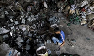 Workers sort CD player parts at a workshop in Guiyu, in China's southern Guangdong province, 2015.