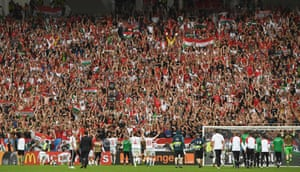 Hungary players celebrate their 2-0 win with their fans.