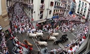 Bulls charge down a street in Pamplona during last year's festival