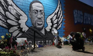 oshua Broussard kneels in front of a memorial and mural that honors George Floyd at the Scott Food Mart corner store in Houston's Third Ward where Mr. Floyd grew up.