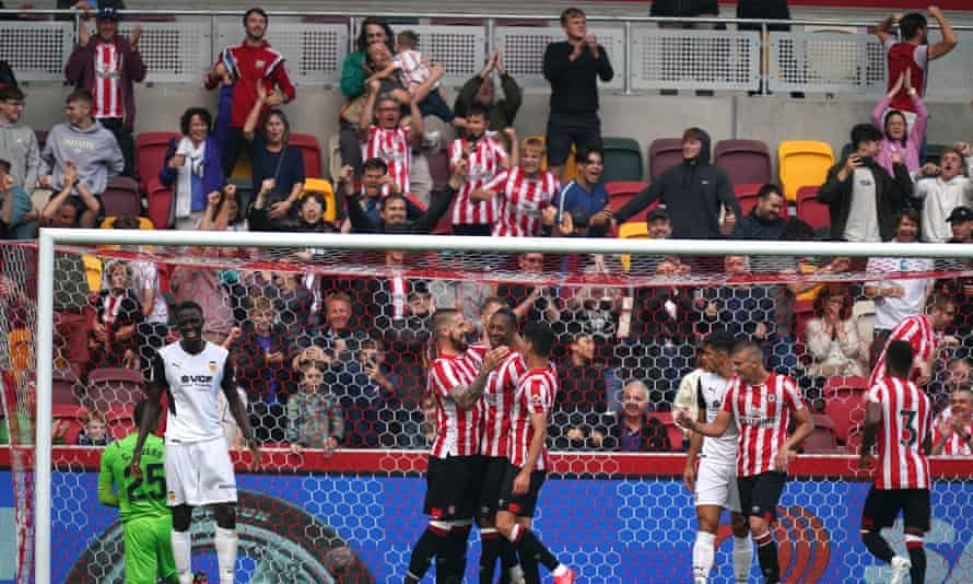 Brentford players and fans celebrate a goal during a pre-season match against Valencia.