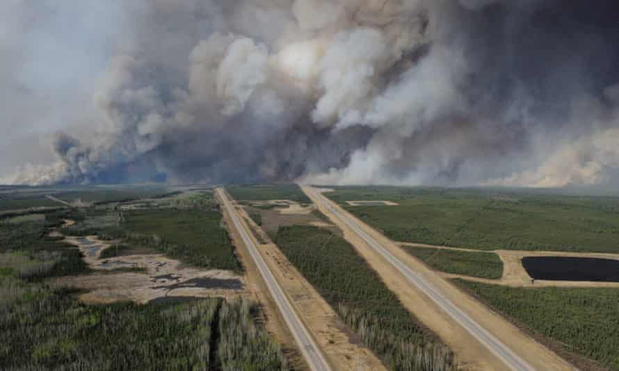 Smoke from fires billows south of Fort McMurray, taken from a CH-146 Griffon helicopter.