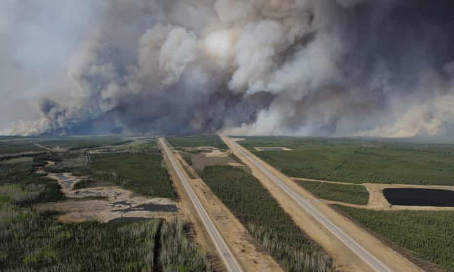 Smoke from fires billows south of Fort McMurray as seen from a helicopter over Highway 63.