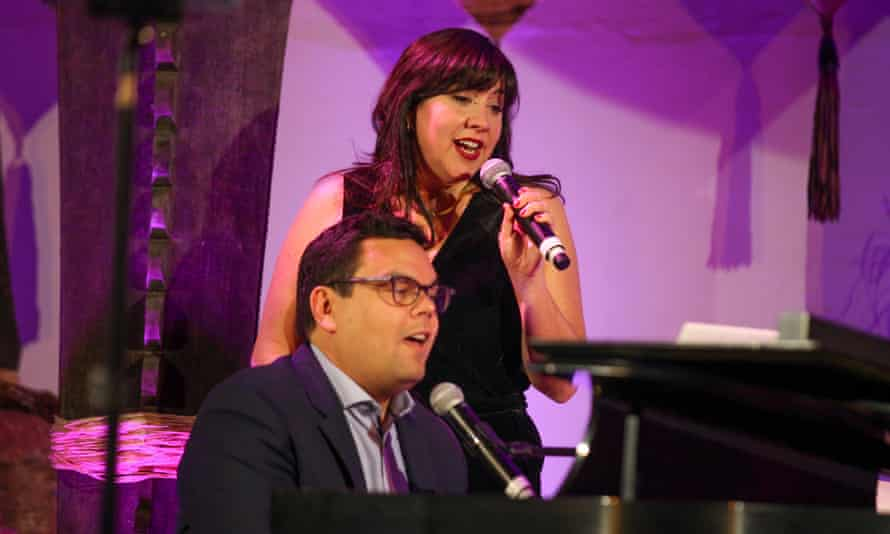 Robert Lopez and Kristen Anderson-Lopez performing together in 2017 in San Francisco.