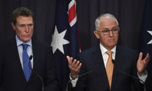 Australian prime minister Malcolm Turnbull speaks (right) as Australian attorney general Christian Porter looks on during a press conference at Parliament House in Canberra, 13 June 2018.