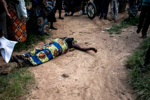 A woman lays prostrate in grief.