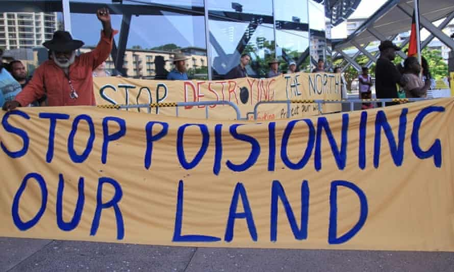 Protesters set up outside a Minerals Council of Australia summit in Darwin in December 2014.